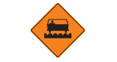 Milled or grooved pavement road safety sign