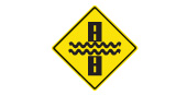 Water covering the road safety sign
