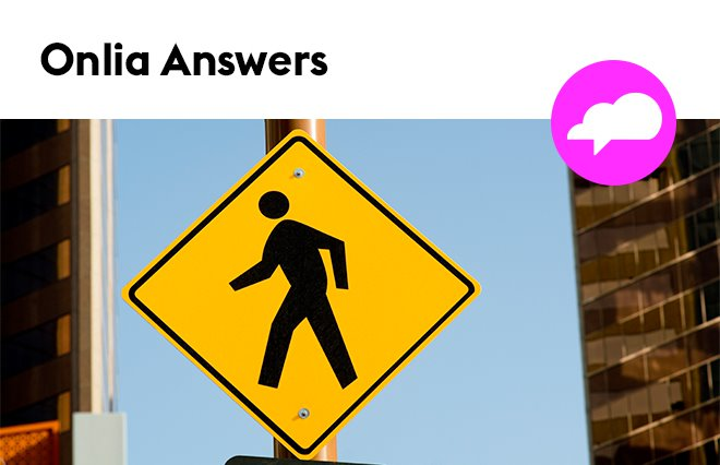 Image of a pedestrian street crossing sign with a header that reads Onlia Answers