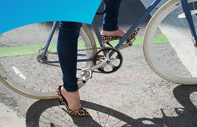 Woman cycling in high heel shoes