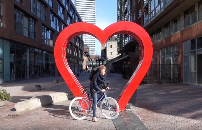 Image of Bonny on her bicycle in the City of Toronto