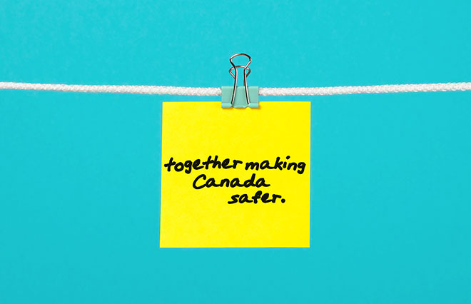 "Post-it note on a string with writing that reads ""Together making Canada safer"""