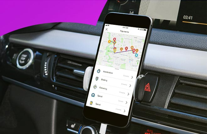 Image of a phone mounted on a car dash with a telematics application open