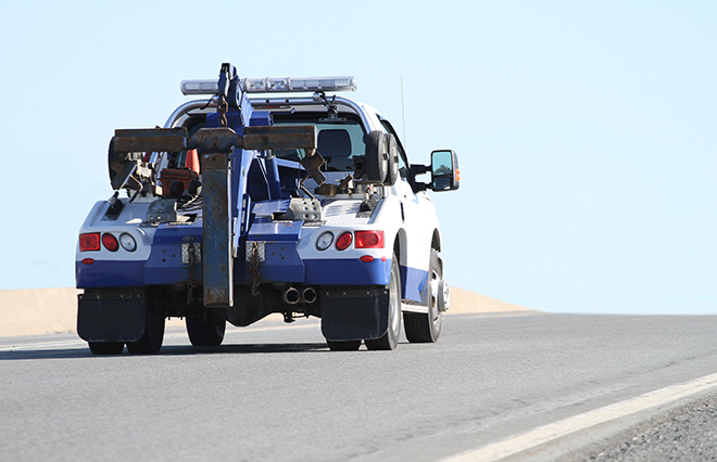 A tow truck driving along the road.